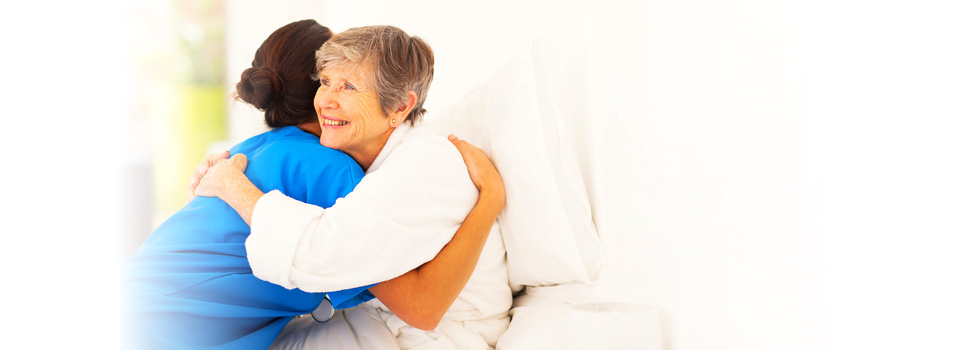 caregiver hugging patient