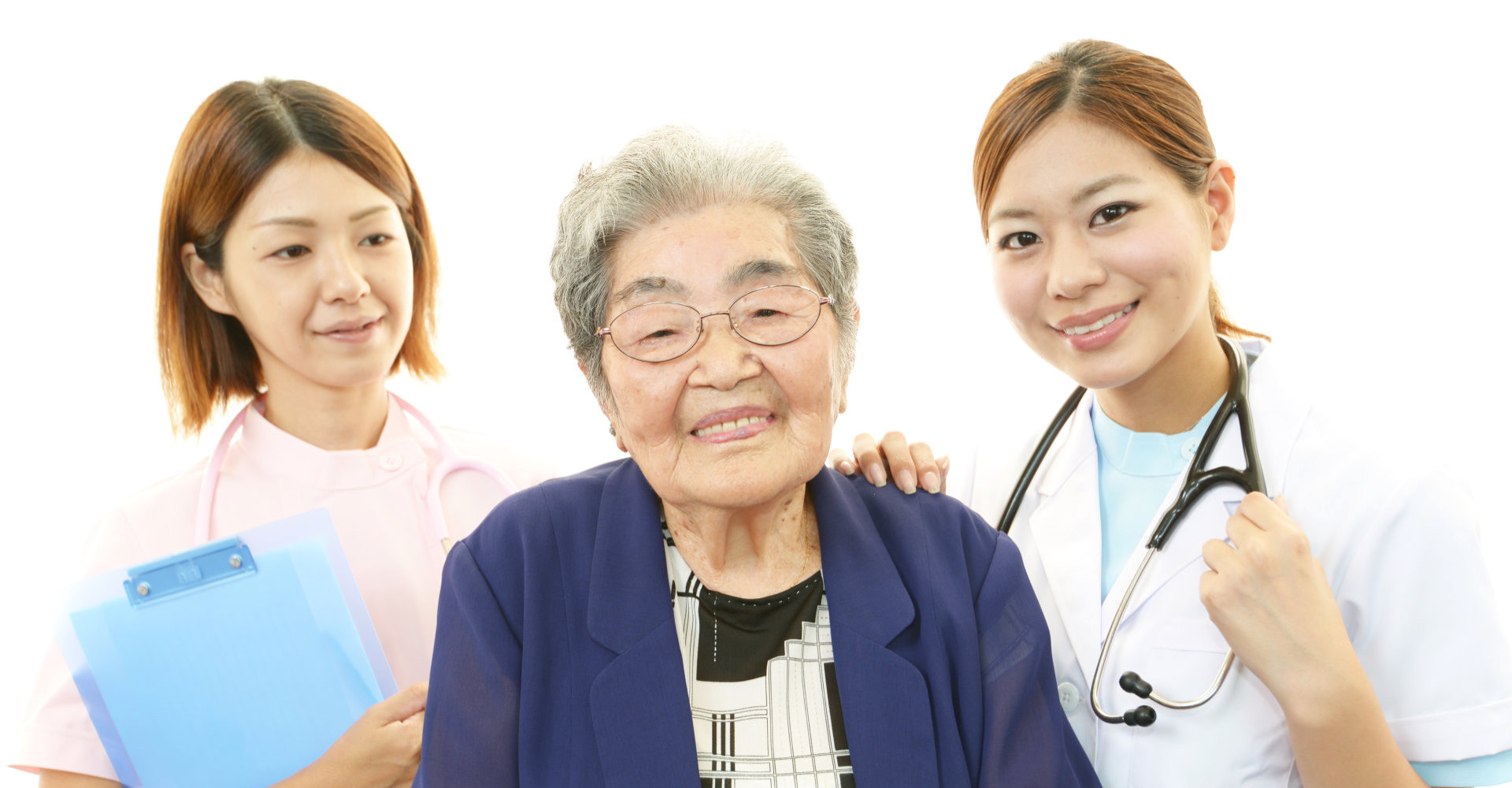 elderly woman and two medical staff smiling