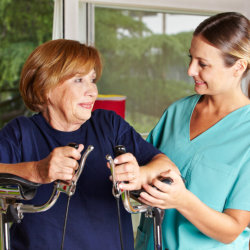 senior woman having physical therapy with her caregiver